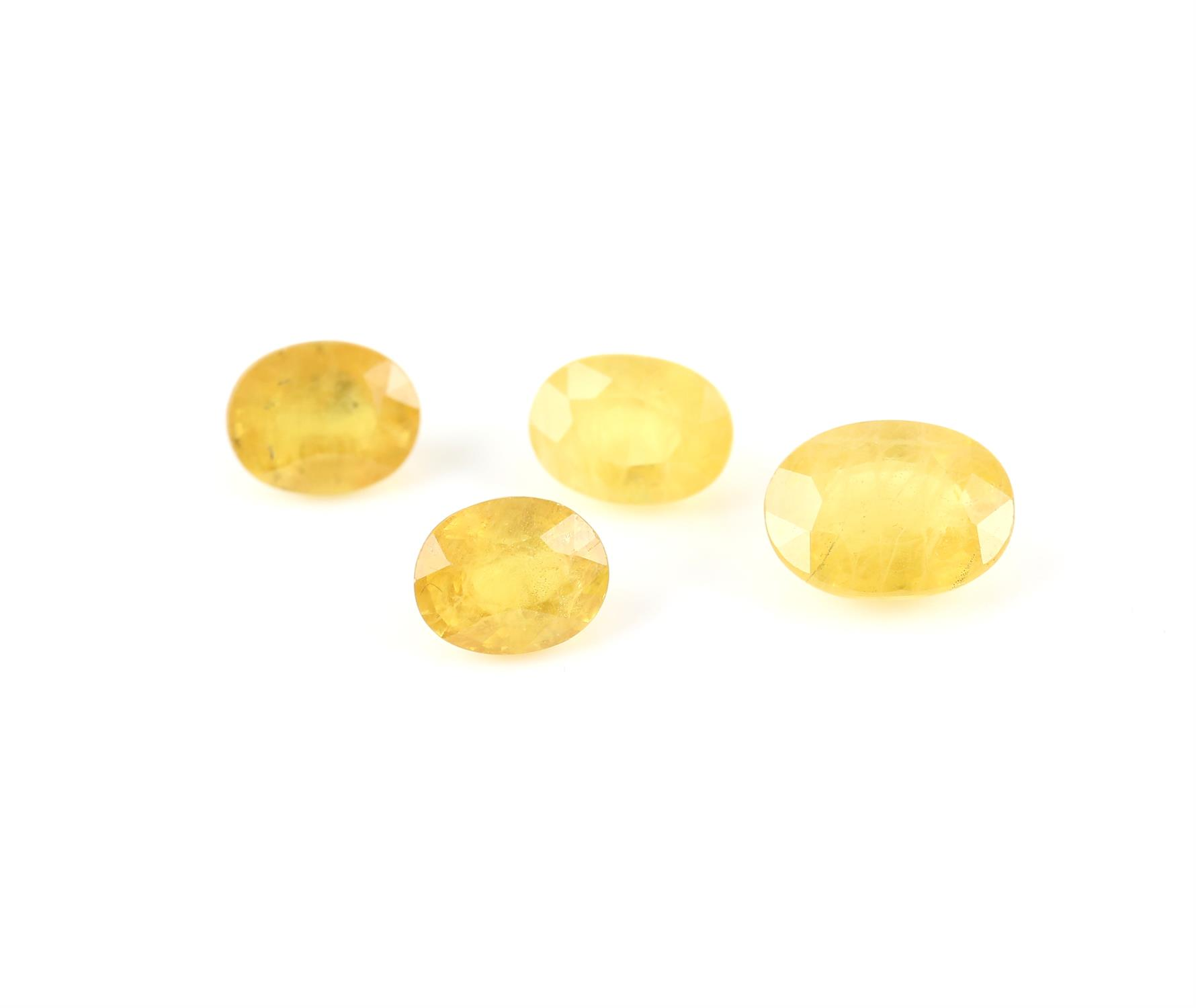 Four faceted oval cut loose synthetic yellow sapphires, weighing an estimated 3.63 carats, 2.