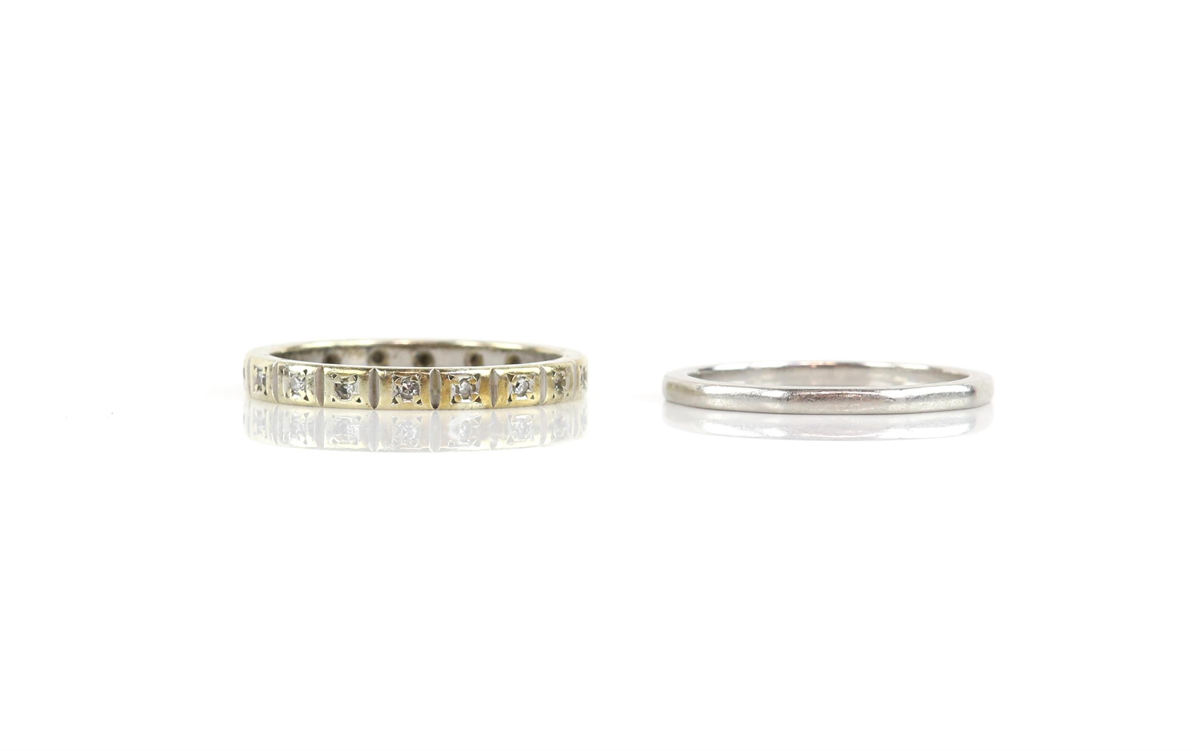 Two rings, one shaped platinum band, size N and a diamond full eternity ring, stamped 9 ct,