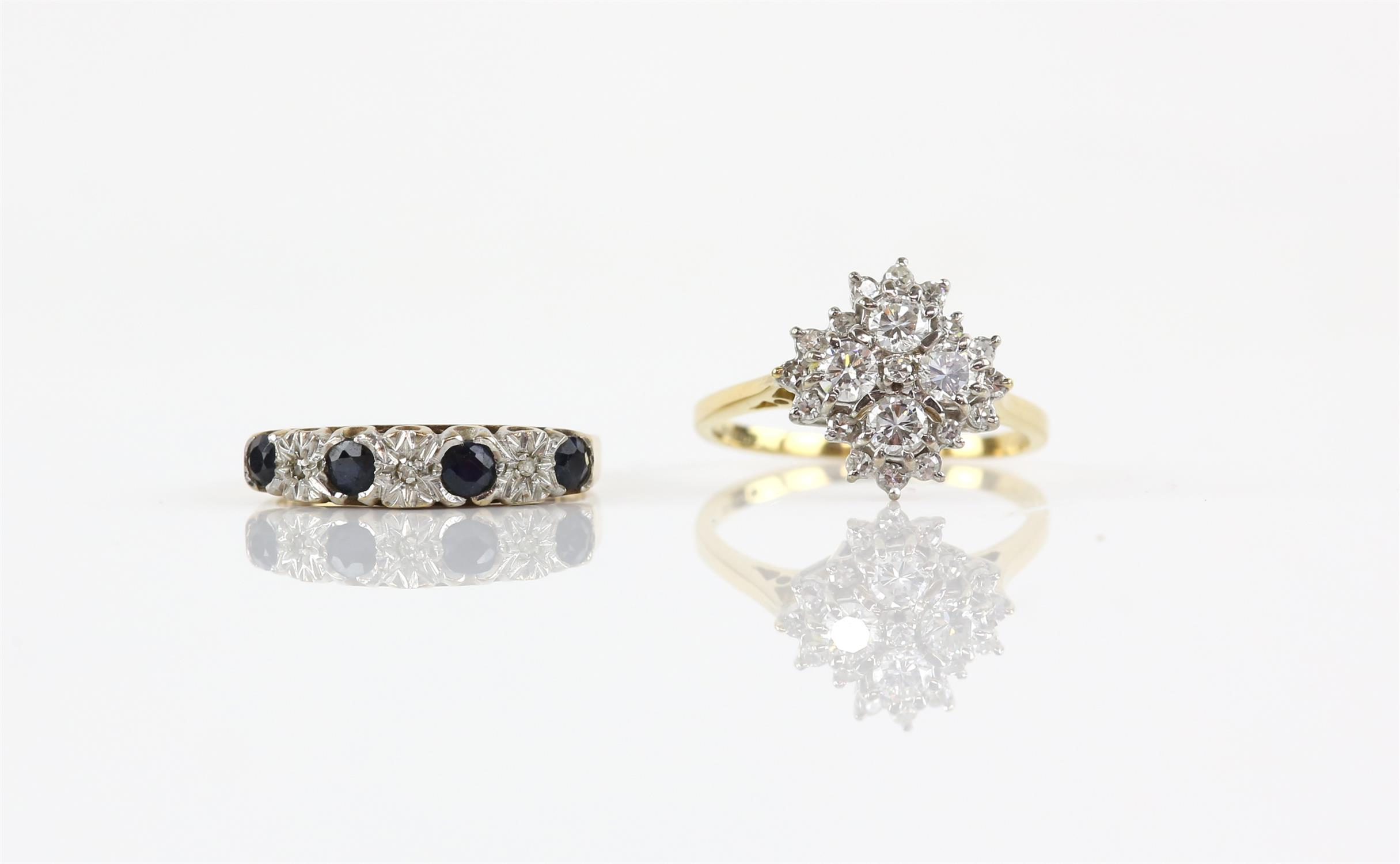 Two gem set rings, including a diamond cluster ring, weighing an estimated total of 1.00 carat,