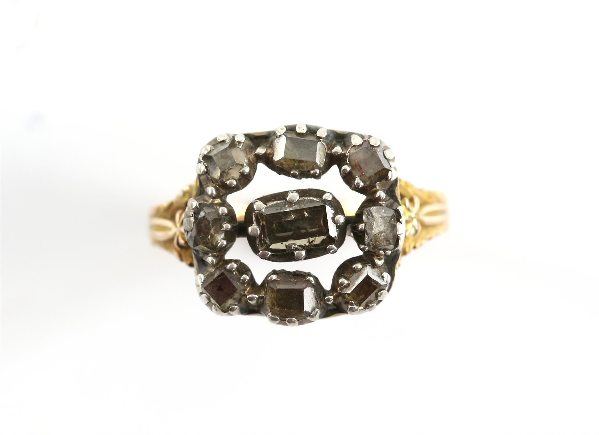 Antique diamond set ring, set with table, old cut and rose cut diamonds, mounted in silver,