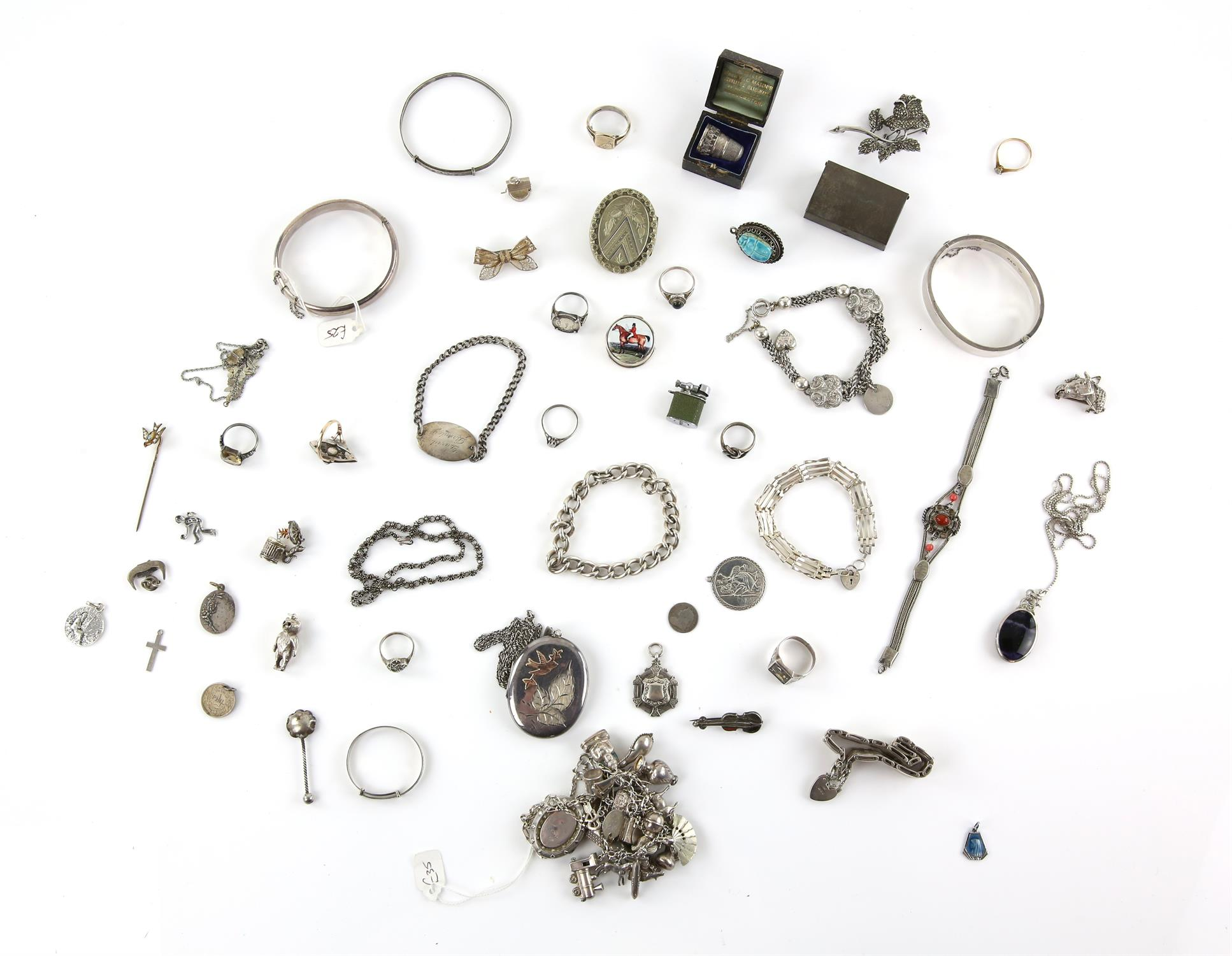 Antique mainly silver costume jewellery to include bangles, brooches, large and small lockets,