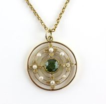 Edwardian pendant, centrally set with a round cut peridot, estimated weight 1.39 carats,