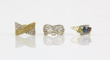 Three diamond dress rings, including a multi-row diamond crossover ring, ring size P,