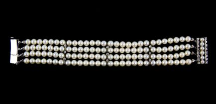 Pearl and diamond bracelet, four rows of cultured white pearls, measuring 5.8mm in diameter,