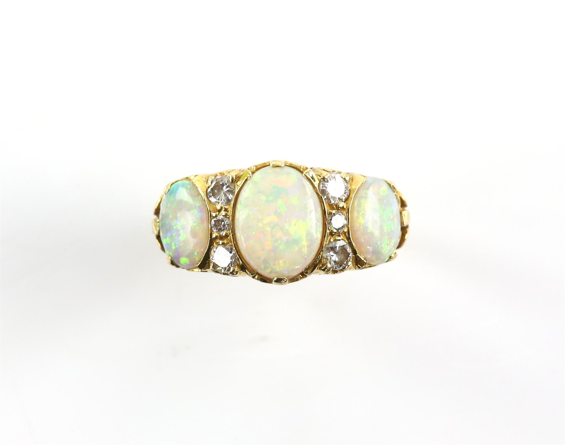 Vintage opal and diamond ring, the centre opal is a synthetic, the side stones are natural,