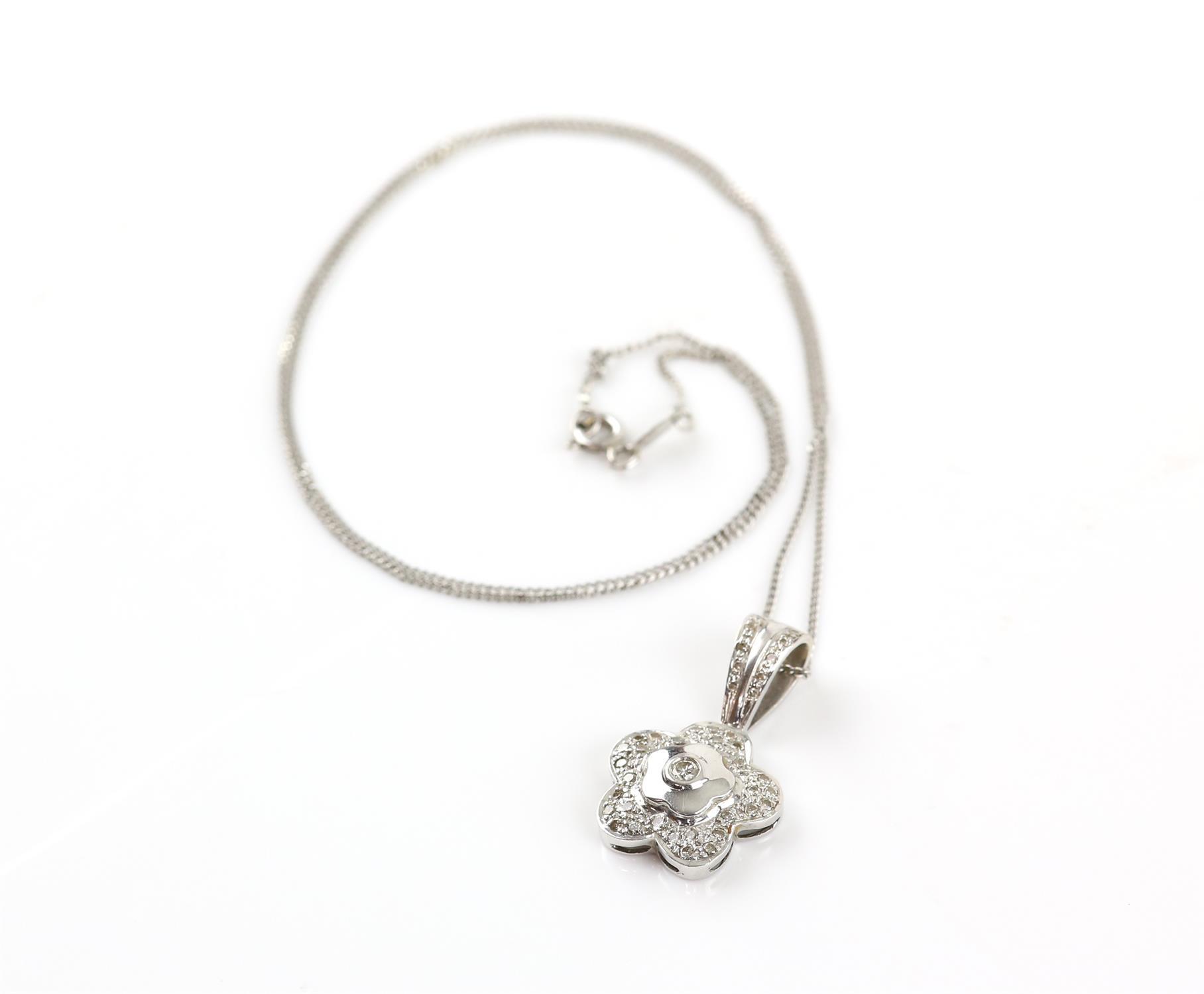 Diamond flower pendant, set with round brilliant cut diamonds, on a diamond set bail, - Image 3 of 3