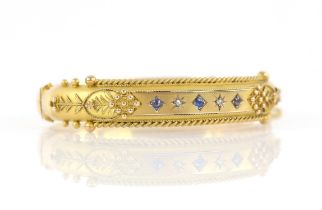 Edwardian diamond and blue paste set bangle, with wirework and floral detailing, concealed clasp