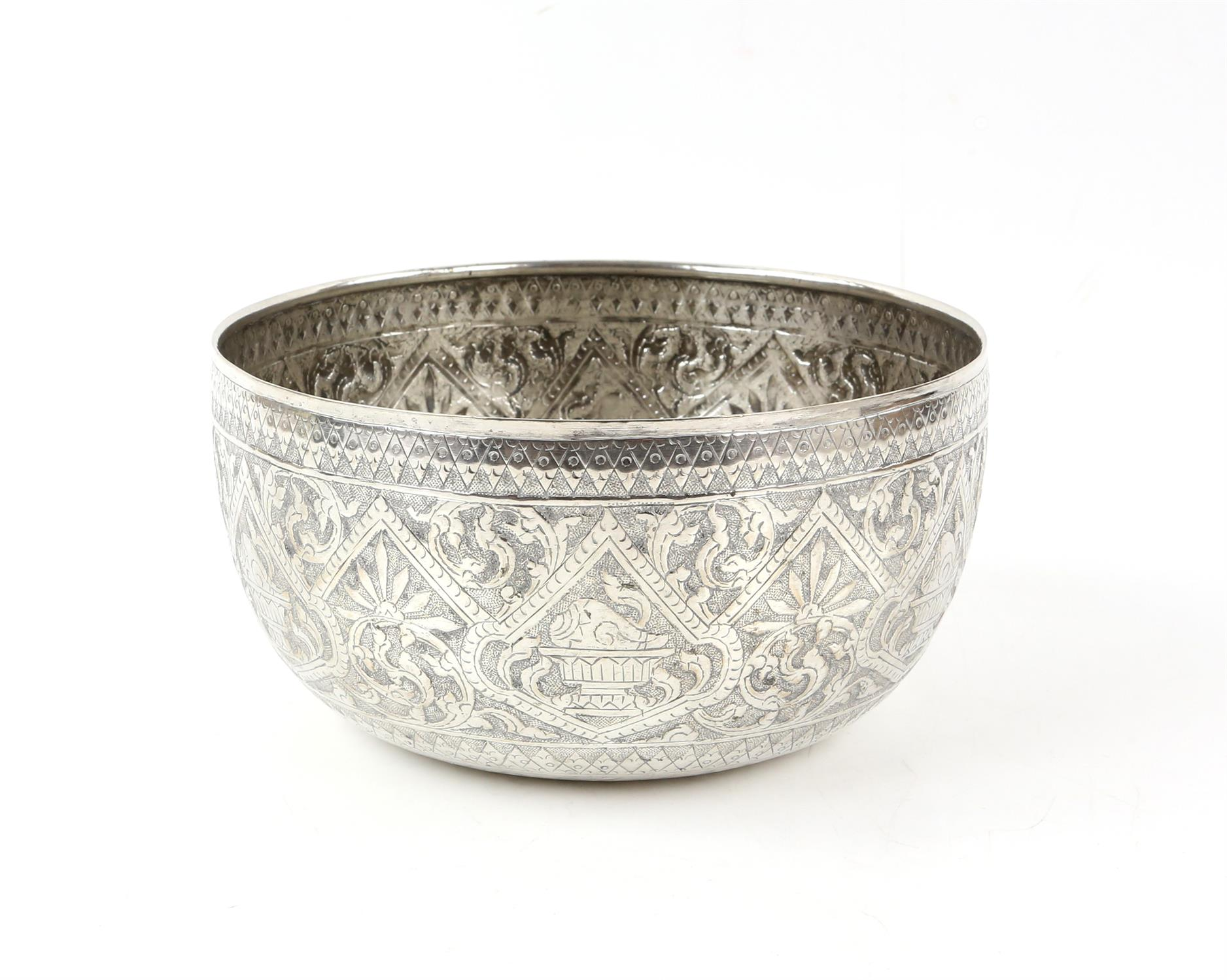 Far Eastern silver bowl with hammered and embossed decoration of repeating shells on plinths, 17.