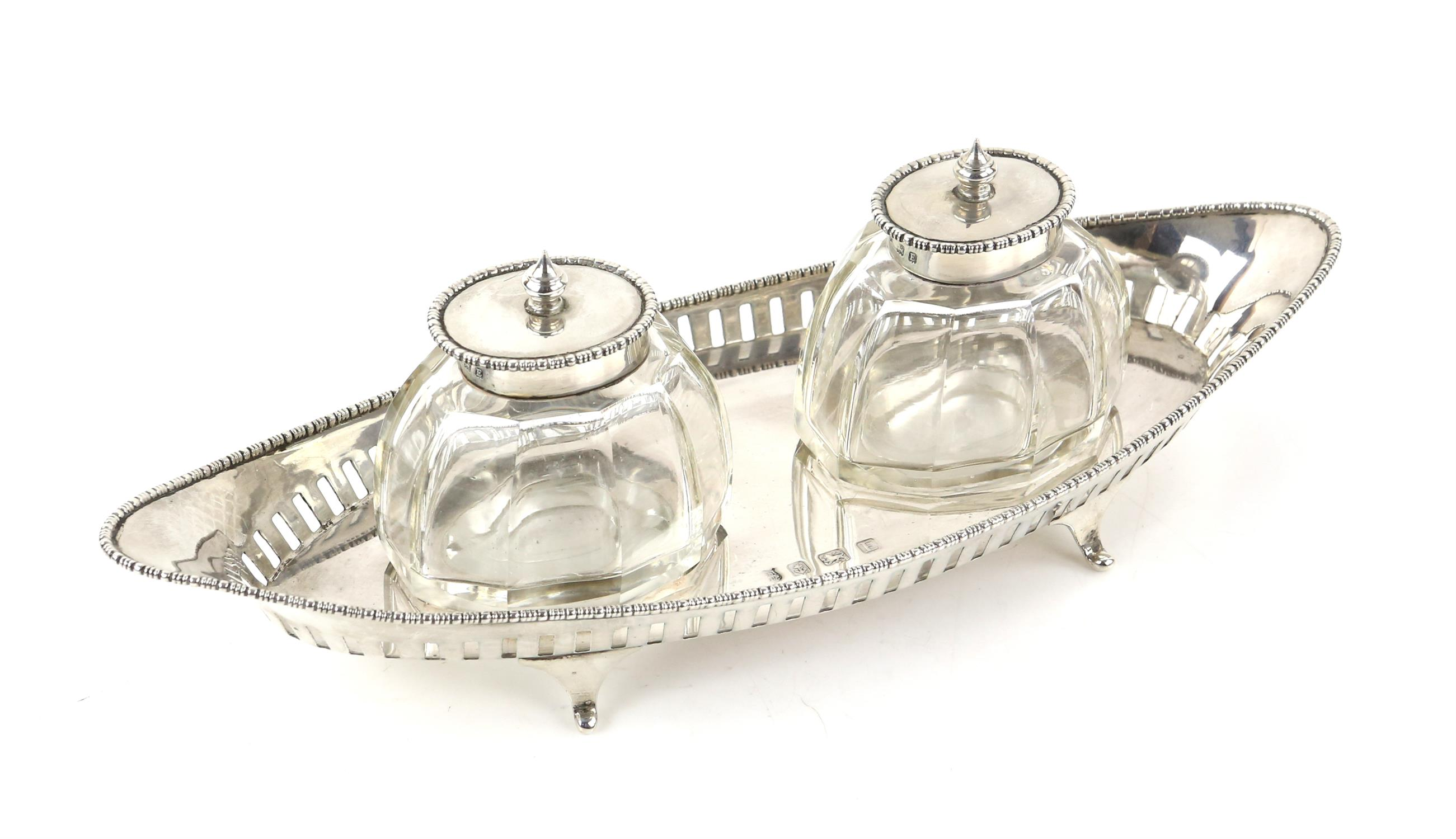 George V silver desk stand of eliptical form with two cut glass and silver mounted inkwells, - Image 2 of 8