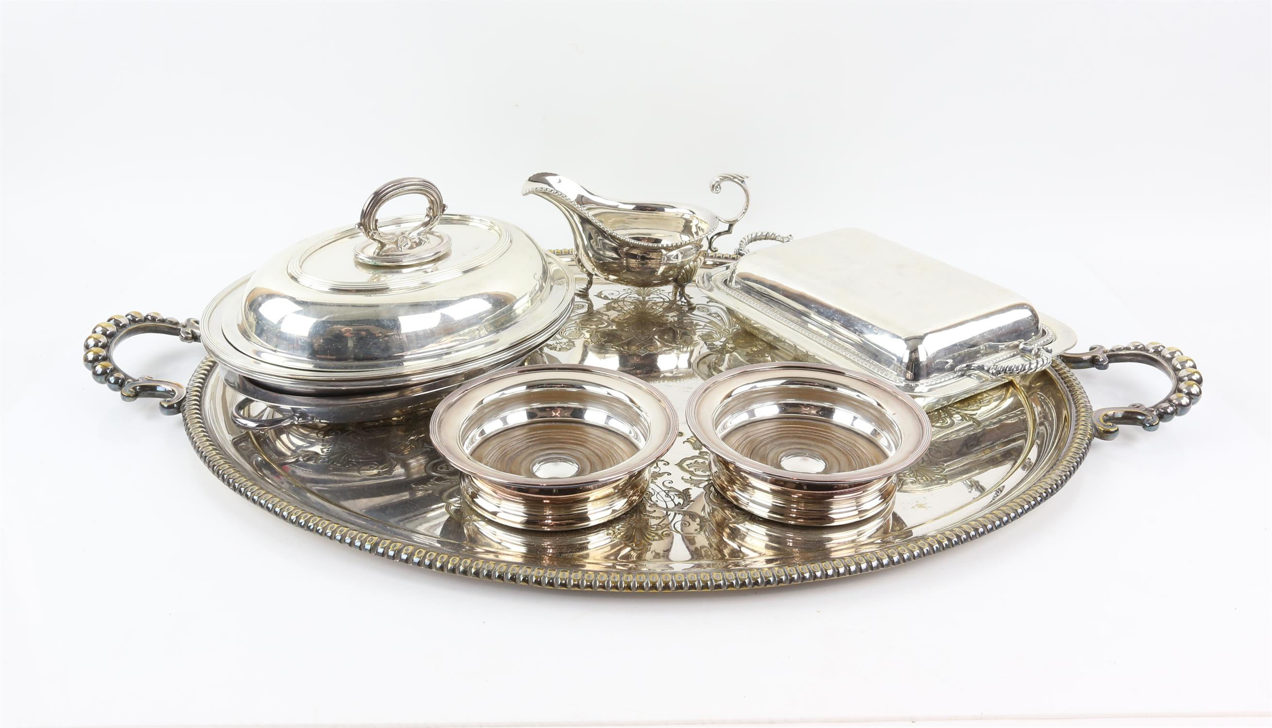 Silver plated twin-handled tray with beaded border, 77cm wide, pair of bottle holders,