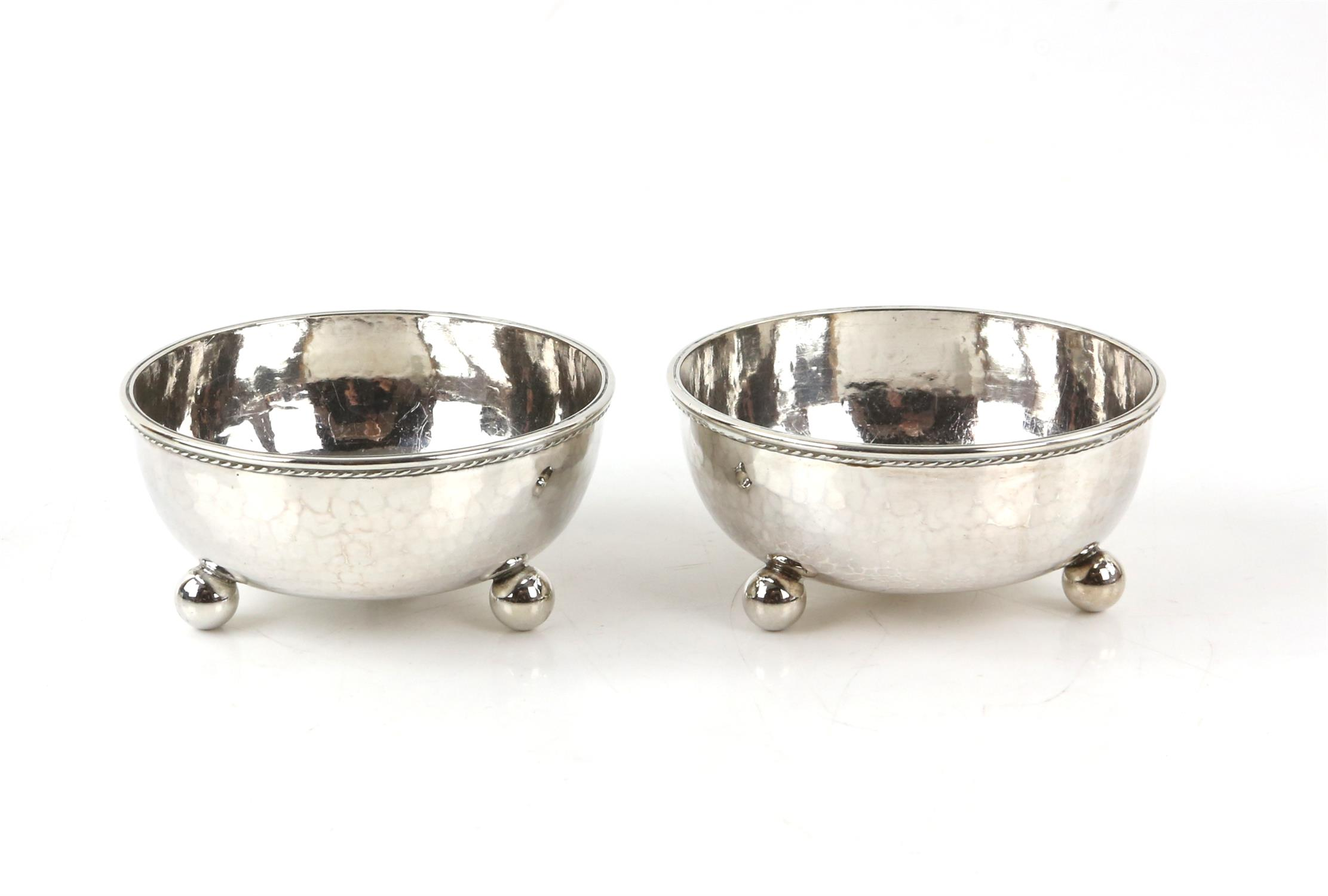 Pair of George V silver bonbon dishes with gadrooned borders, each on three ball feet,