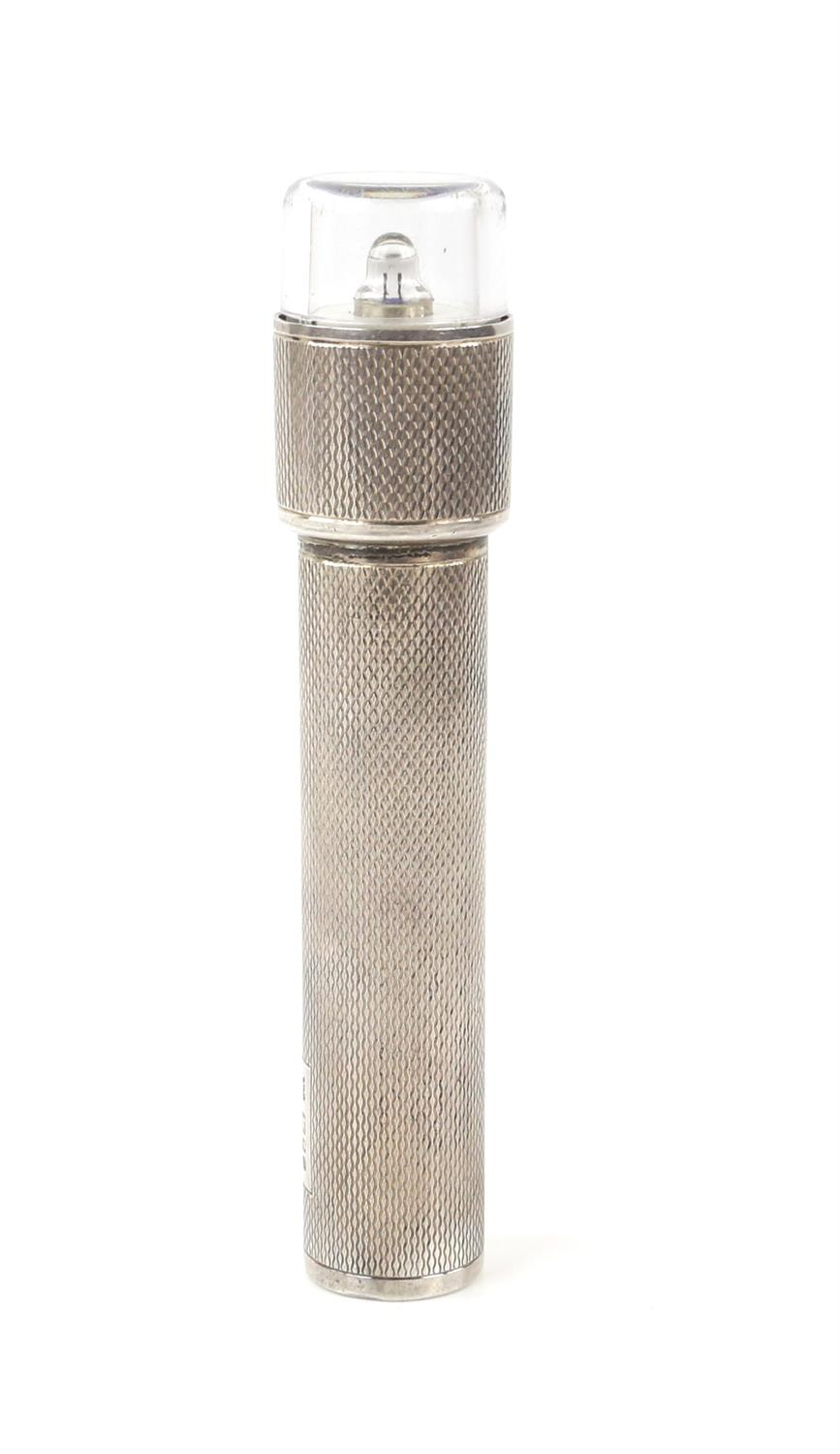 Large silver hand held torch with an engine turned finish and a rectangular vacant cartouche by TP,