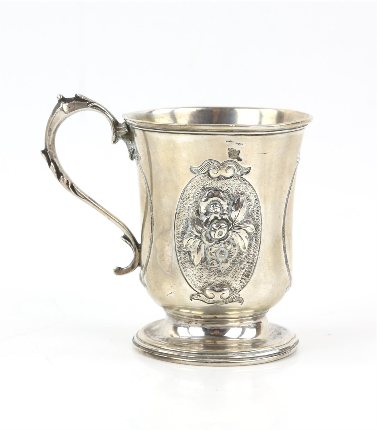 Victorian silver panelled cup/mug the two side panels embossed with a floral design and front panel