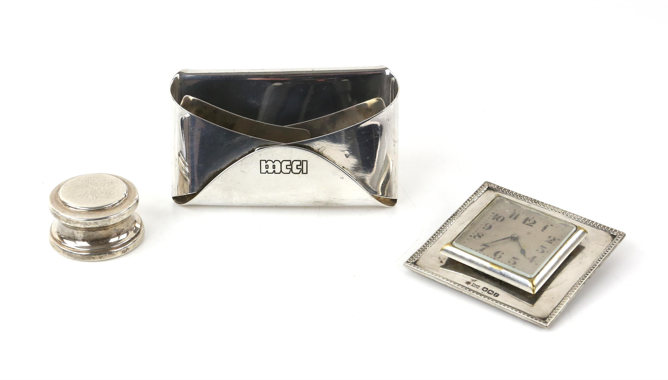 Walker and hall silver framed clock, an Indian silver white metal desk top card holder and a