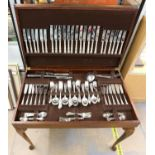 Modern Chinacraft silver plated canteen of cutlery for twelve, in stained beech canteen table,