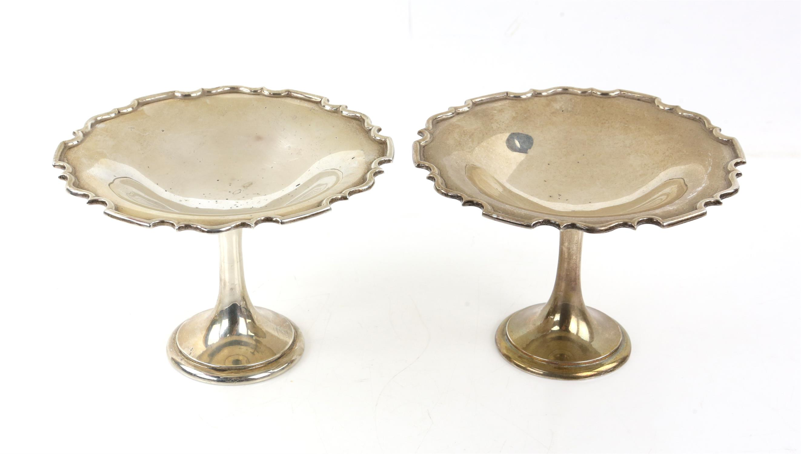 Pair of Mappin and Webb silver pedestal Tazzas with pie crust edges, London 1912