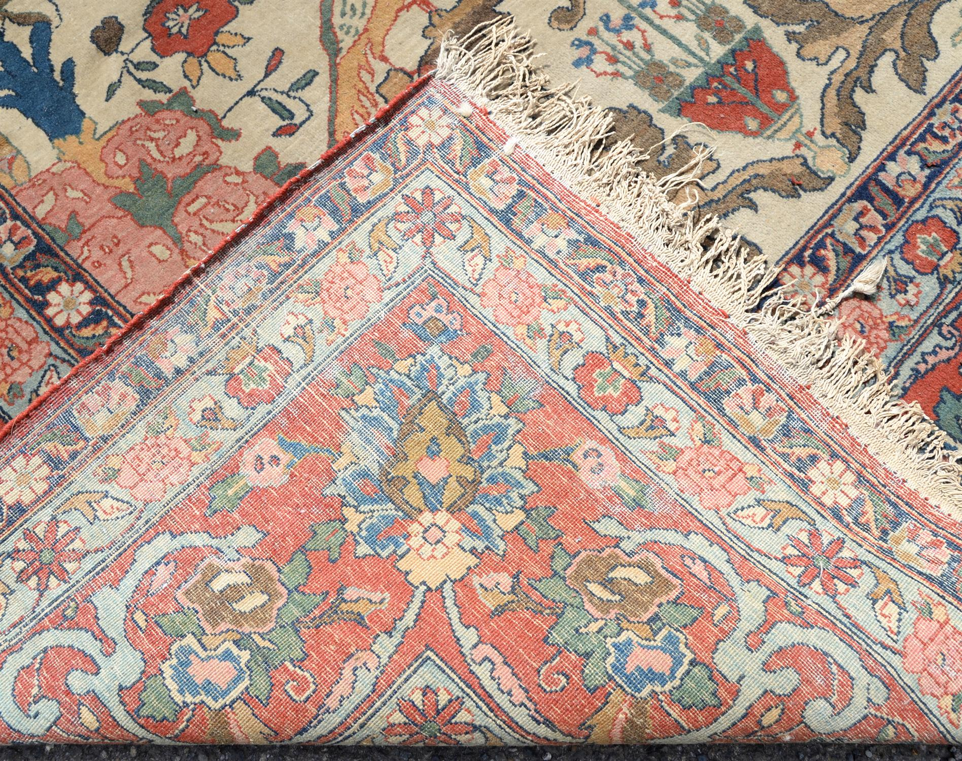 Persian carpet decorated with floral urns, birds and flowers within a floral border, 330 x 238cm - Image 2 of 2