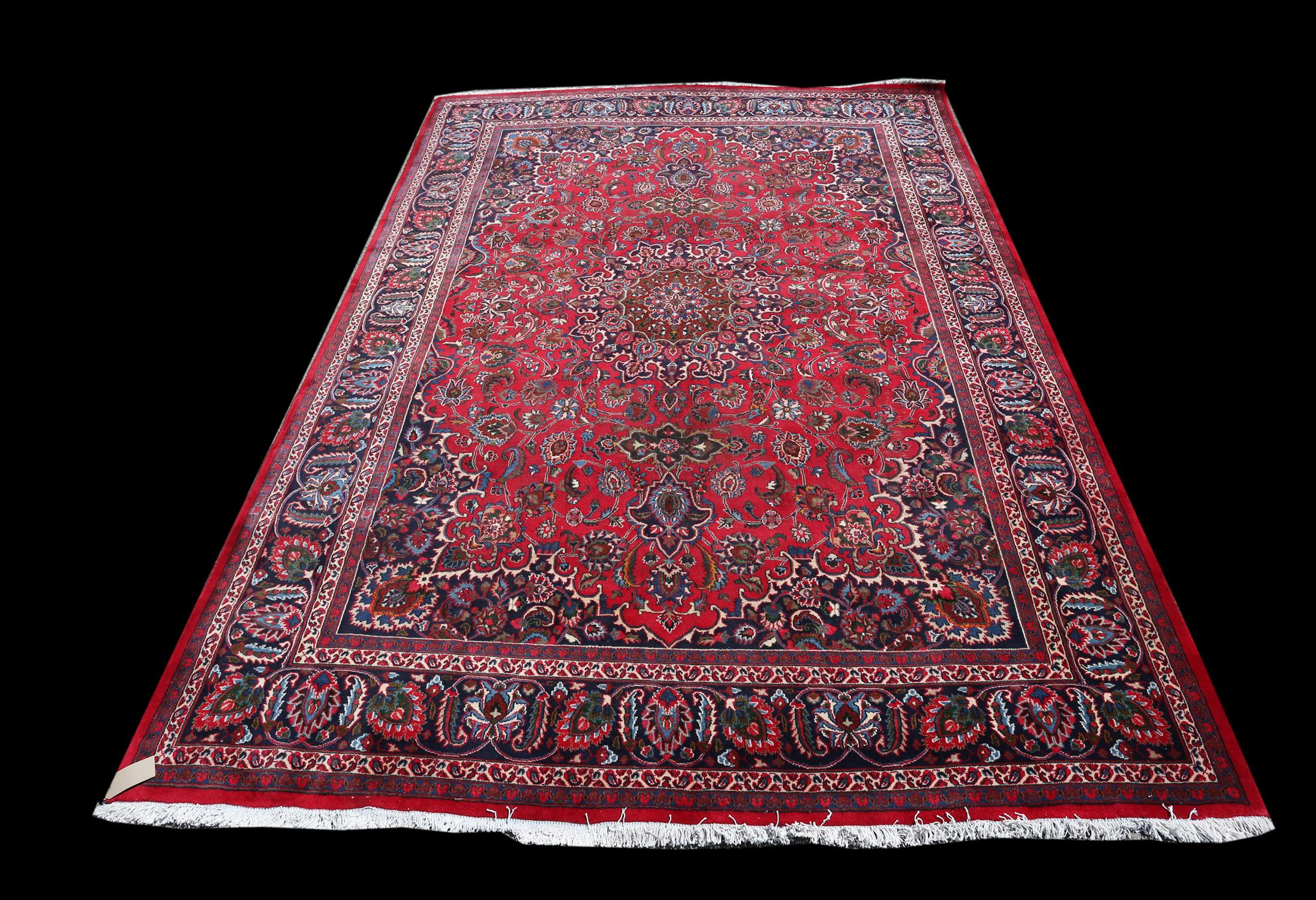 Large Persian full pile Mashad carpet, with traditional pattern of central floral medallion and