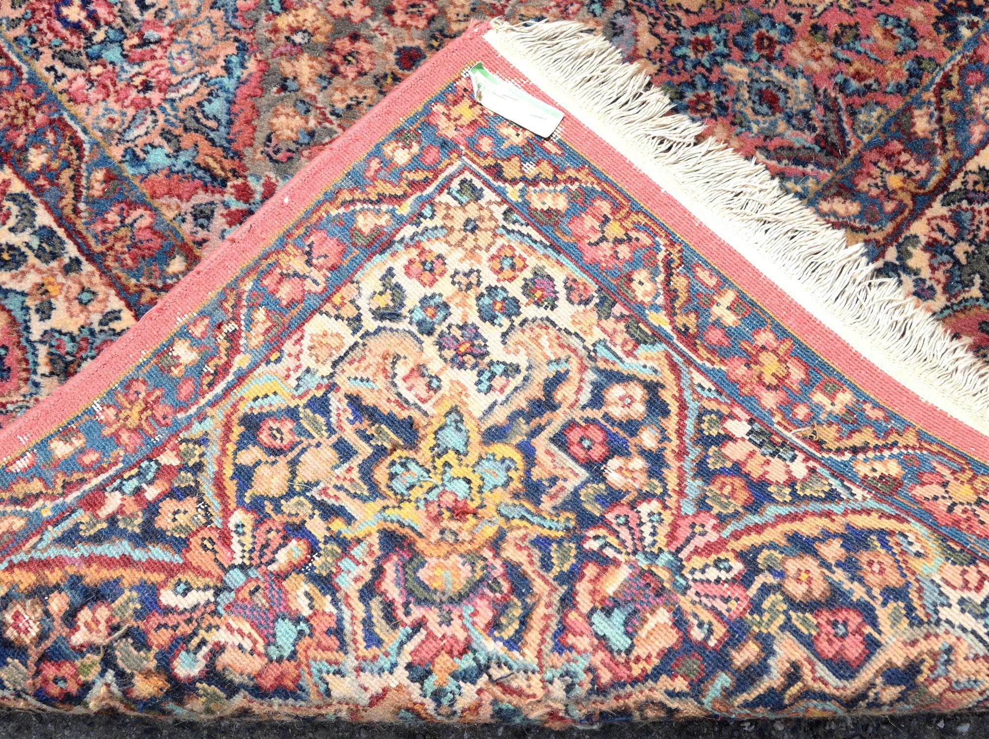 Kirman style woollen carpet by Karastan 'America's Finest Power Loomed Rug', in garden pattern with - Image 2 of 2
