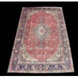 Vintage Persian Tabriz carpet, with central medallion and floral motifs on a pink ground within