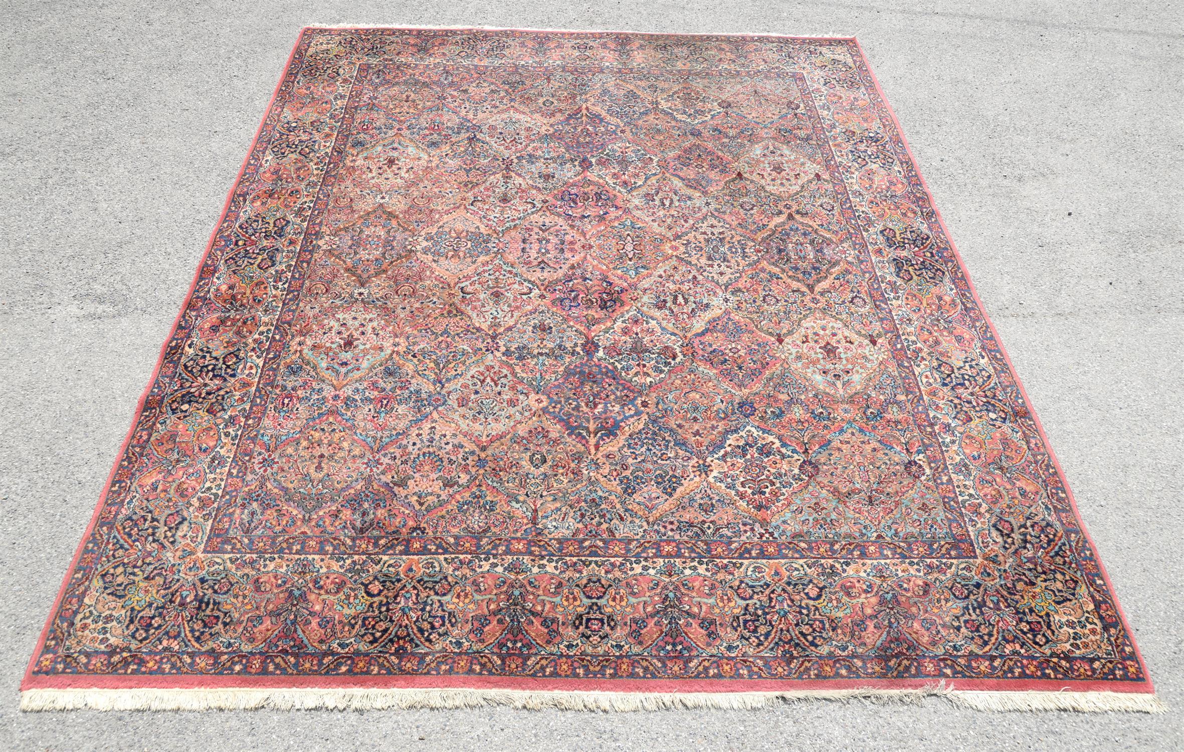 Kirman style woollen carpet by Karastan 'America's Finest Power Loomed Rug', in garden pattern with