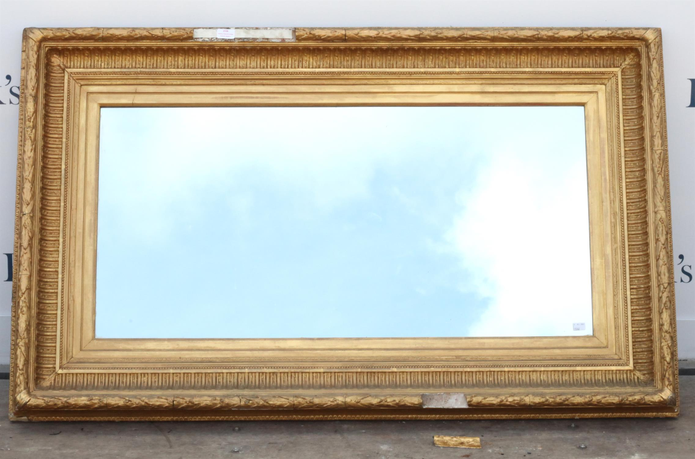 Early 20th century giltwood mirror with rectangular glass plate and floral frame, 86 x 140cm
