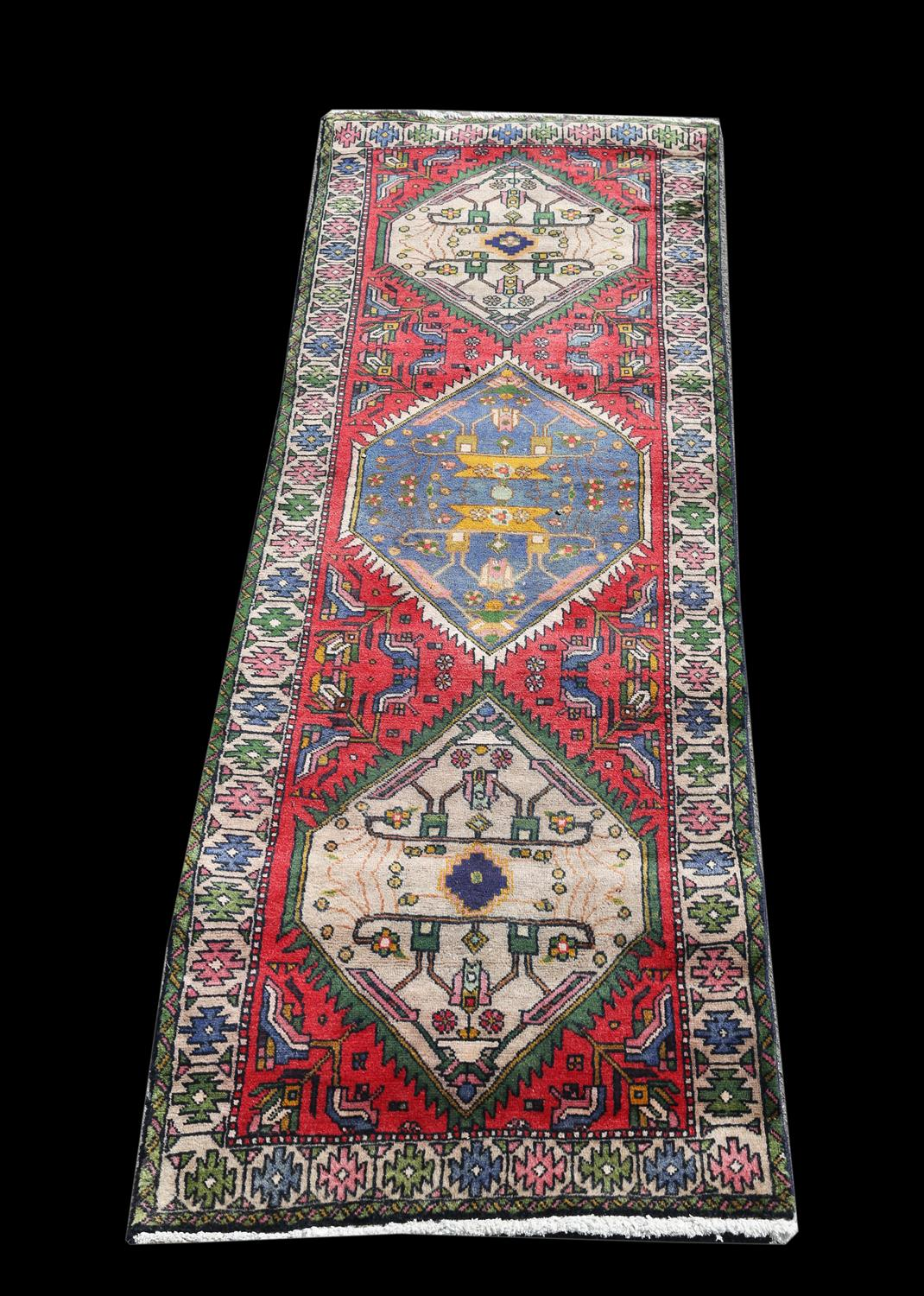 Vintage Persian runner, Northern Iran, with three diamond medallions and stylised floral motifs on