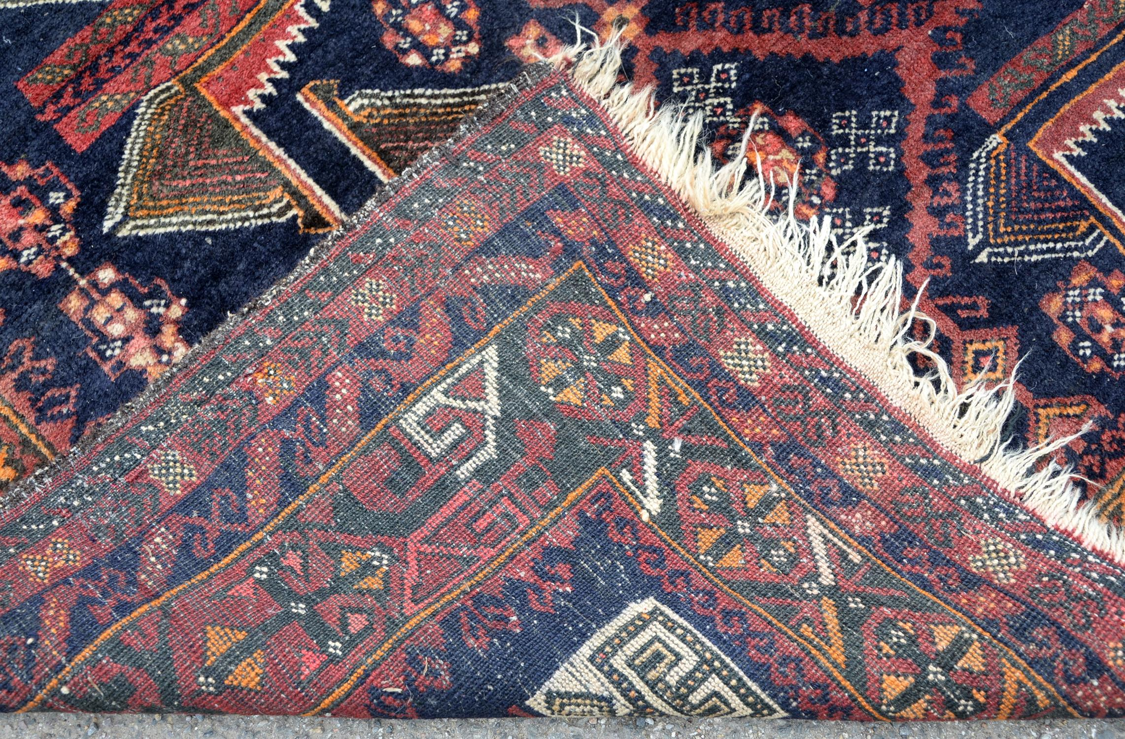 Pakistan rug in the Afghan style, having stylised motifs echoing the war in Afghanistan on a blue - Image 2 of 2