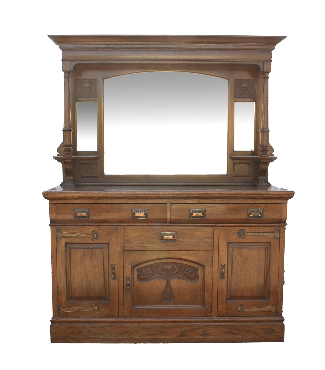 Art Nouveau mirrored back oak sideboard, with bevelled glass plates flanked by floral carved panels