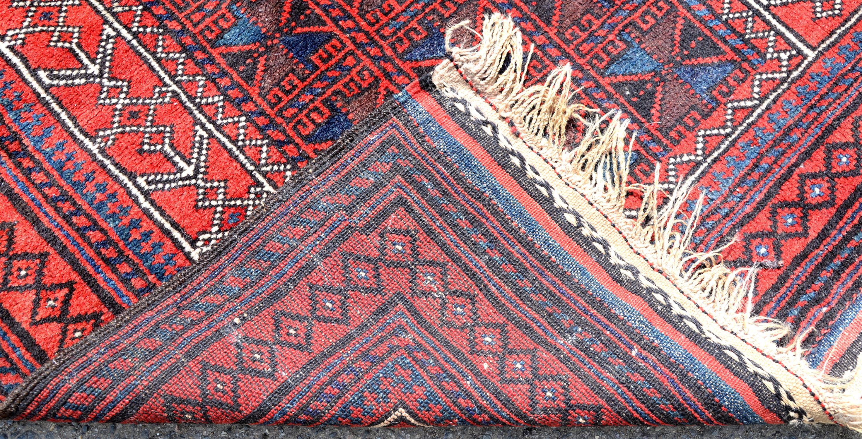 Persian red ground prayer rug, with geometric design within geometric border, 126 x 91cm - Image 2 of 2