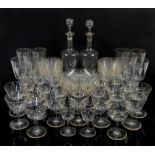 Collection of glassware with etched family crest depicting a hand holding a scimitar, edged in gilt,