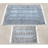 Bokhara style rug with repeating gul motifs on a blue grey ground, within stylised floral motifs,