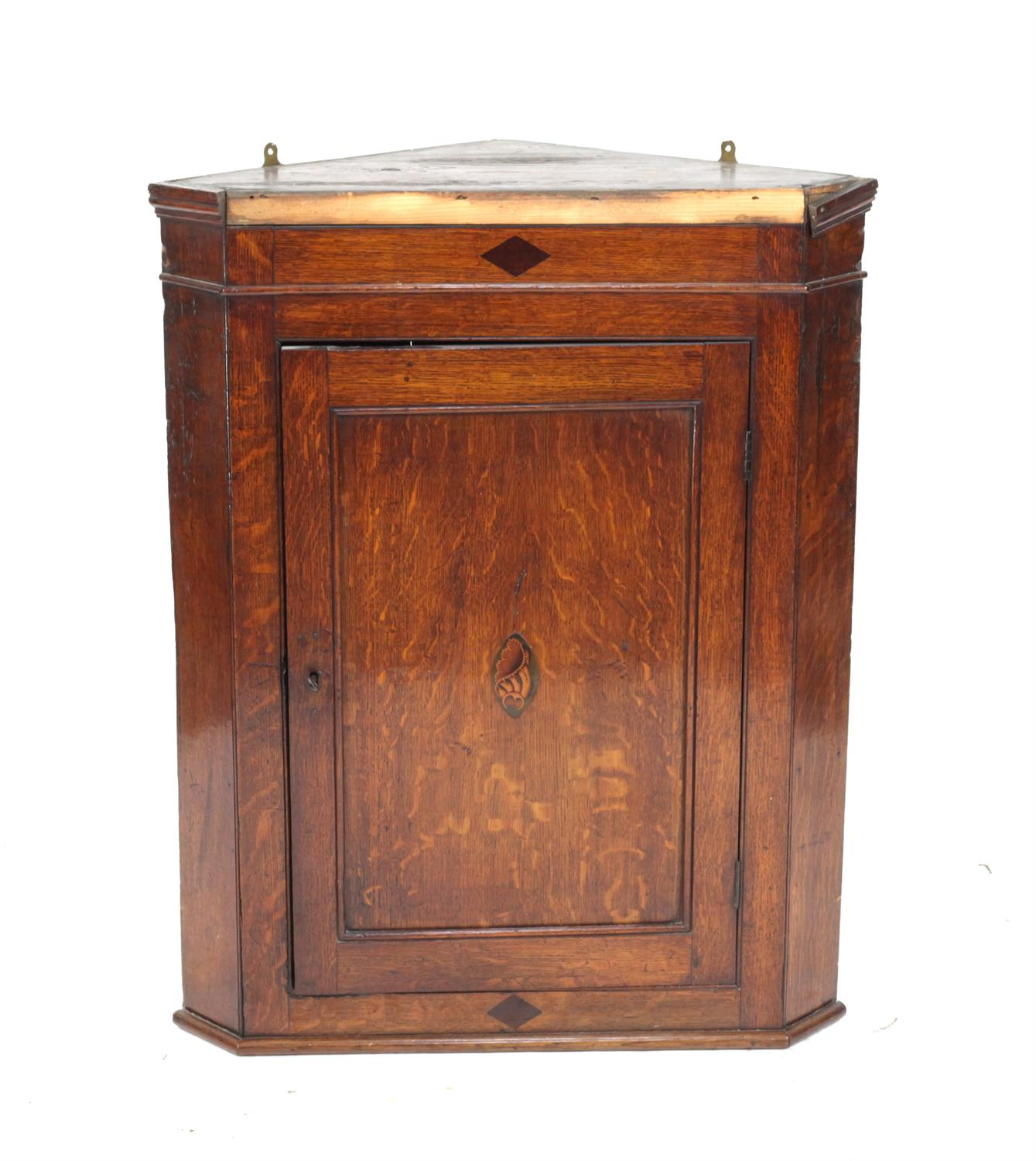 19th century oak wall hanging oak corner cabinet, with marquetry inlaid shell patera, H93 x W73.