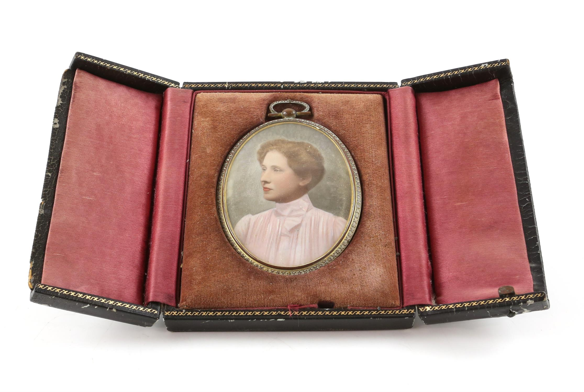Early 20th century portrait miniature of a lady in a high-collared blouse with her hair up,