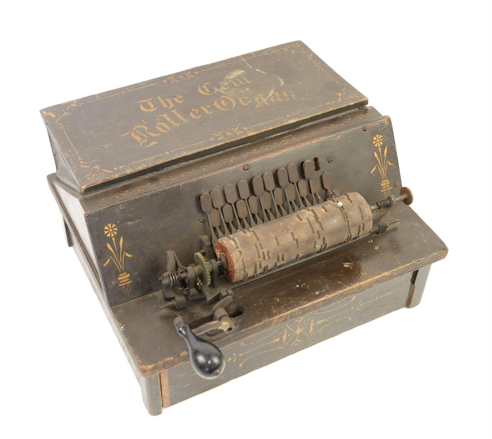 """Late 19th century twenty-key """"Gem Roller Organ"""", in painted wooden case, with one music cylinders,"""