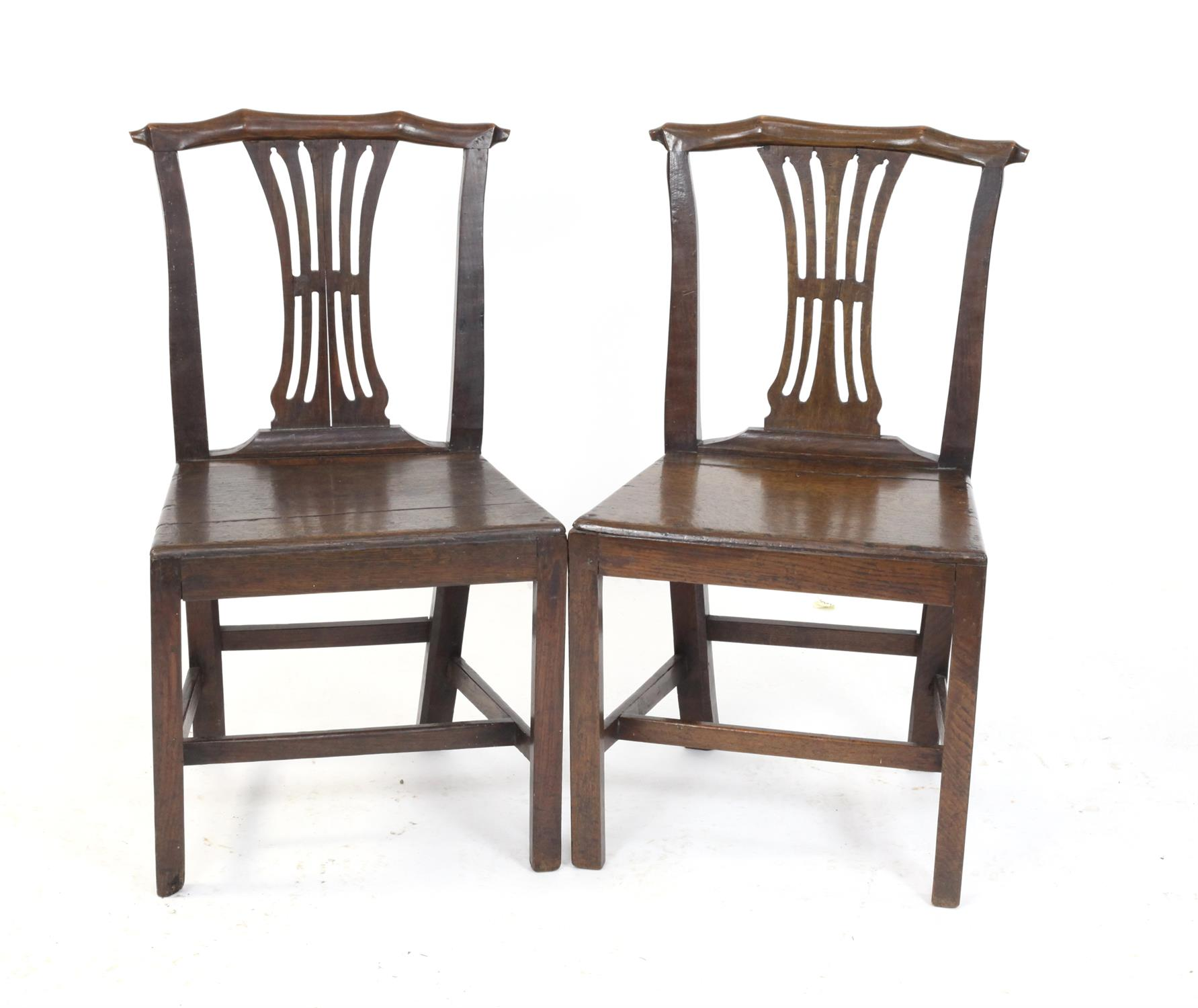 Pair of early 19th century oak country made dining chairs with carved splat backs on square