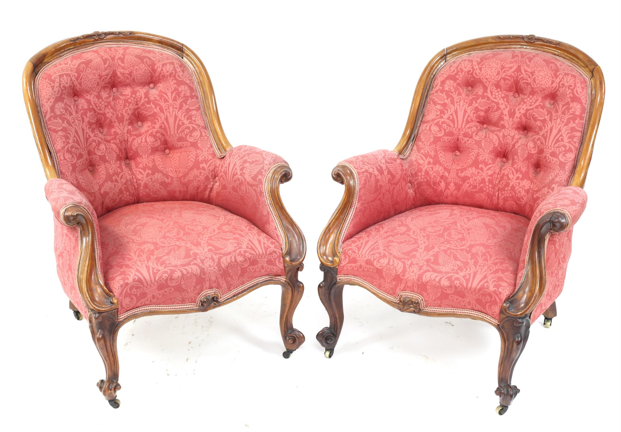 Pair of Victorian rosewood armchairs, with floral upholstery and scroll arms on cabriole legs and