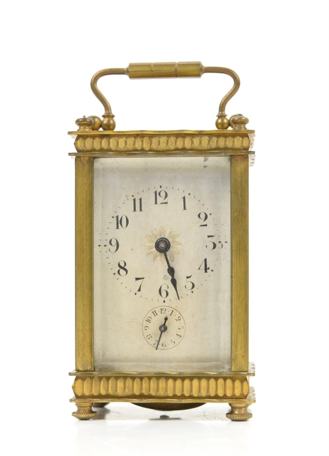 French brass carriage clock, the silvered dial with Arabic numerals and seconds subsidiary dial,