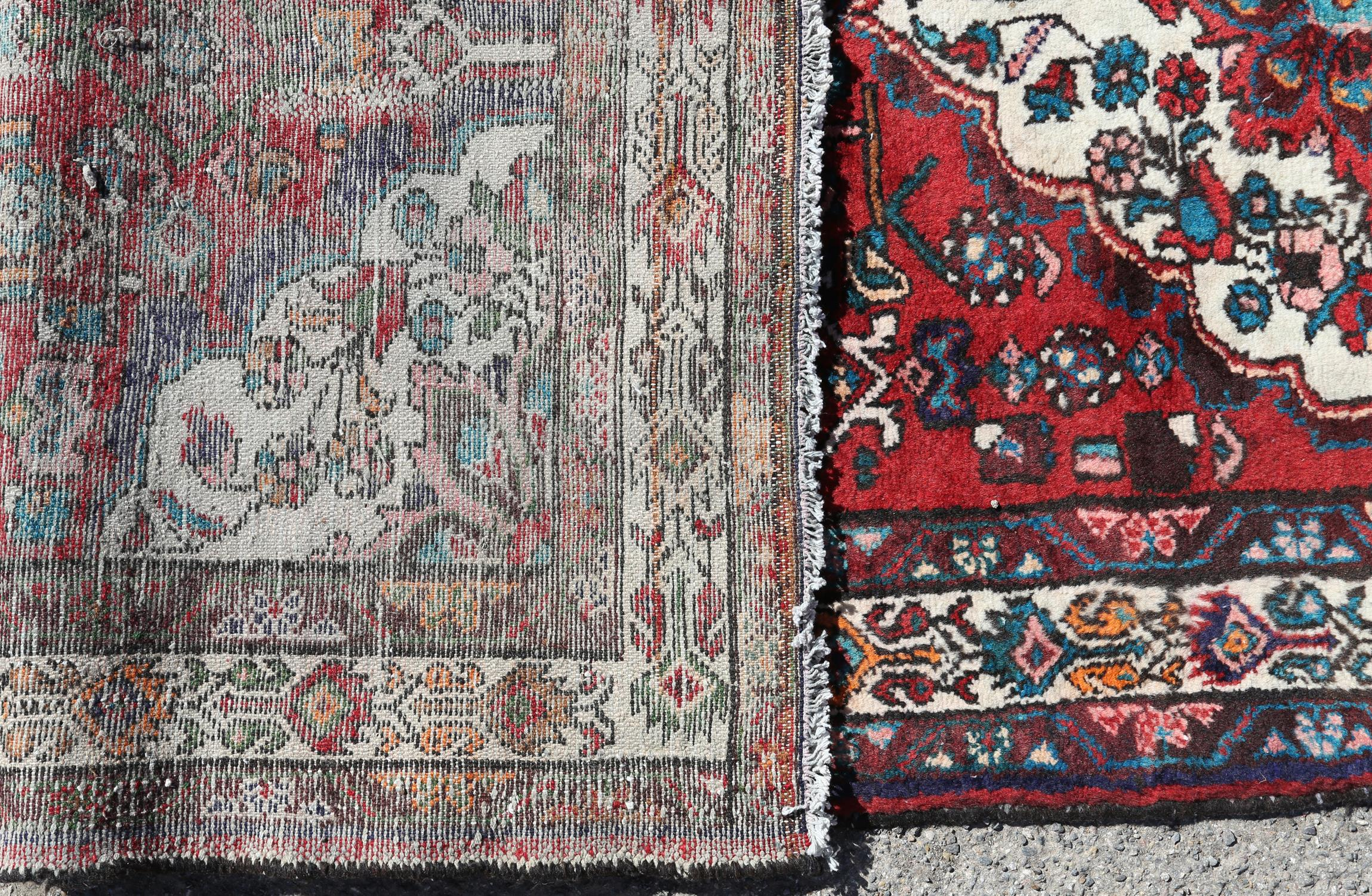 Persian village runner with floral medallion and floral motifs on a red ground, within floral - Image 4 of 4