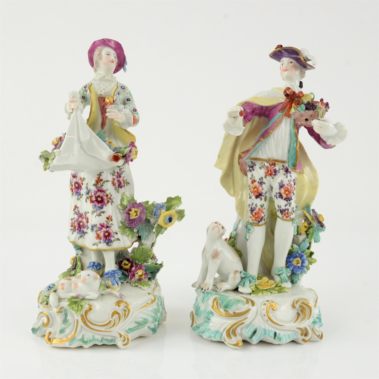 Pair of Derby style porcelain figures of a man holding a basket of fruit and a woman gathering