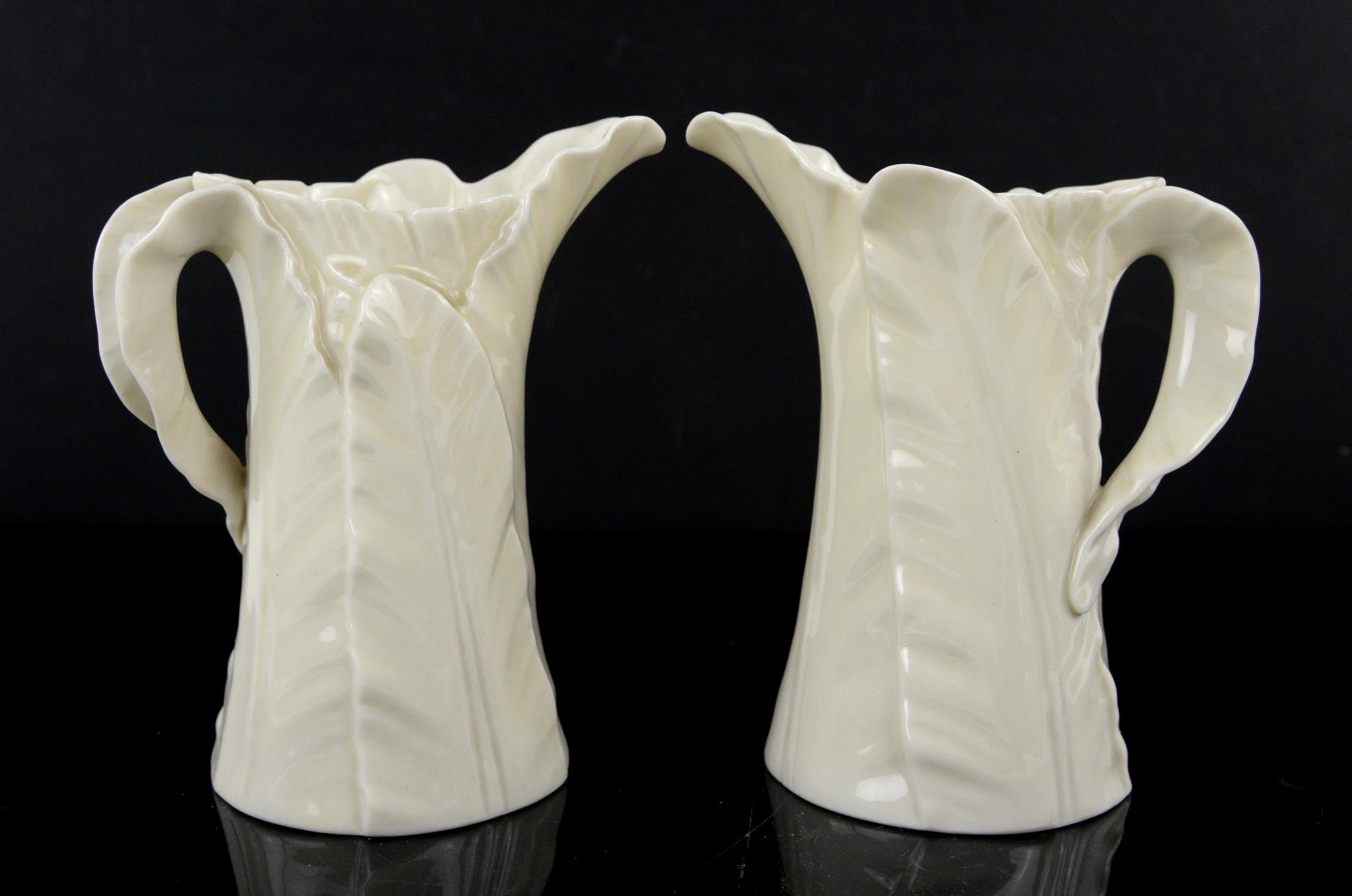 Two Royal Worcester leaf jugs, circa 1920s, green printed marks to base, h15cm