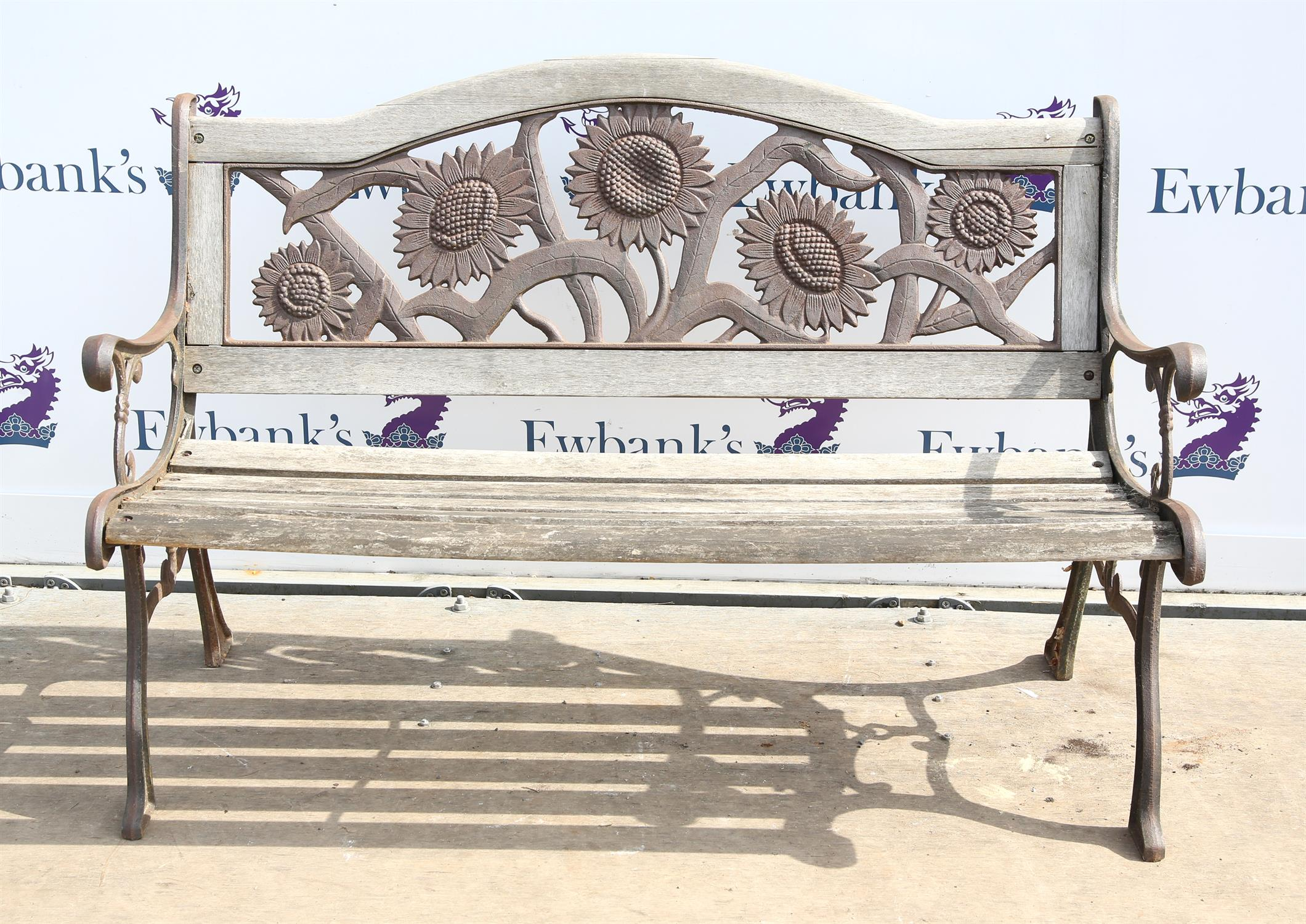 19th century wrought iron and weathered teak garden bench, with pierced wrought iron backrest with