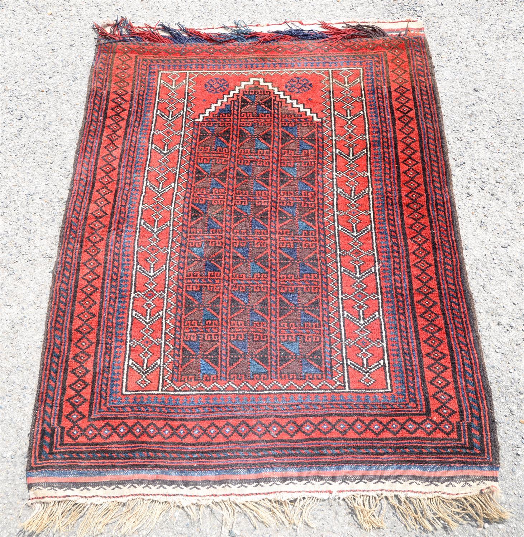Persian red ground prayer rug, with geometric design within geometric border, 126 x 91cm