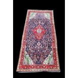 Persian rich blue ground carpet with central floral medallion and floral motifs within floral