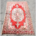 Vintage Iranian rug with central medallion on a red ground within a floral border, 247 x 153cm