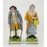 Staffordshire porcelain pair of figures, a man on crutches and woman with a walking stick, h21cm
