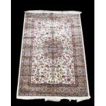 Ivory ground rug, Kashmir, with Shah Abbas medallion design within a floral border, 170 x 120cm