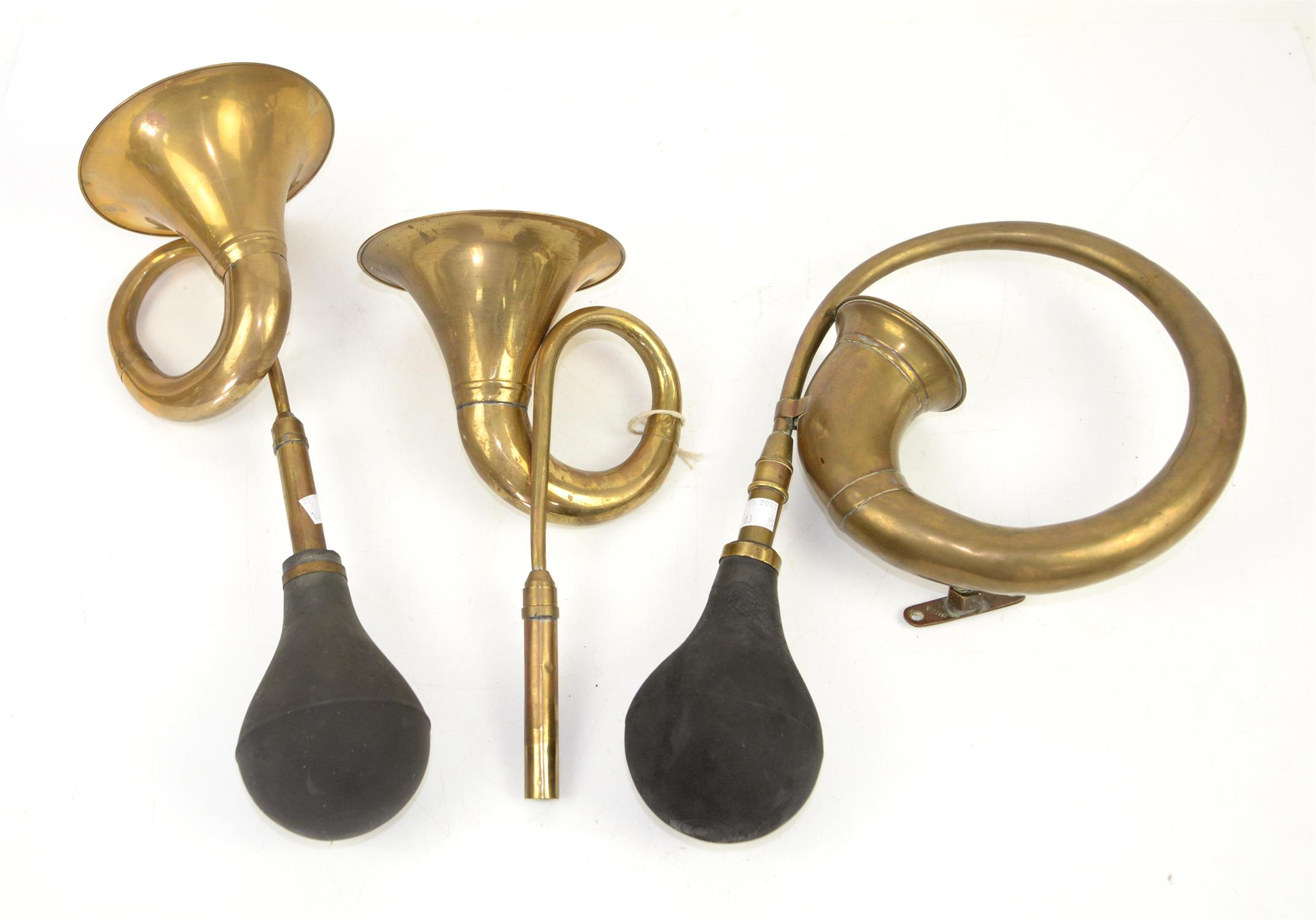 Vintage brass car horn and two later car horns