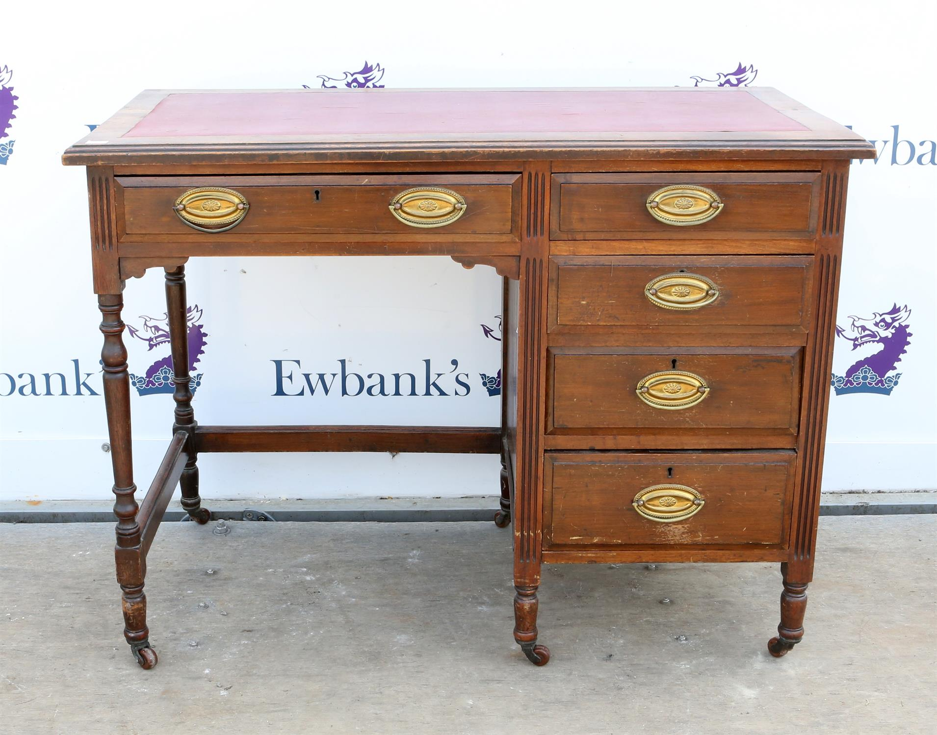 Early 20th century Maple & Co walnut desk, with five drawers on turned supports, H74 x W99 x D51cm