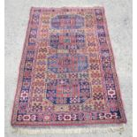 Persian design rug with four medallions on mustard ground, 181 x 104cm